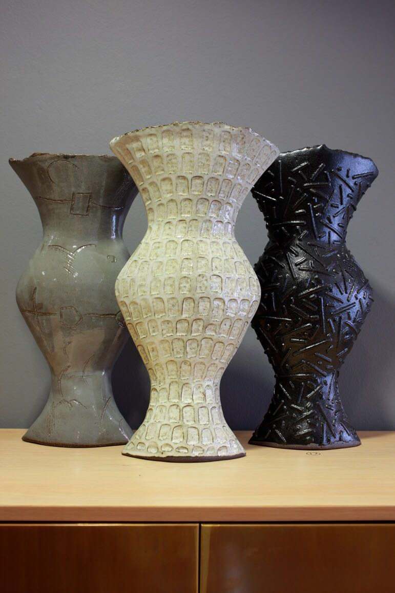 Tall vases by Clementina in a Solo exhibition - Poetry in African Clay at Ebony gallery